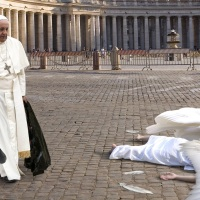 Pope Cleans Up Dead Angel Who Flew Into Sistine Chapel Window  (from The Onion)l